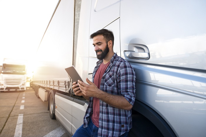 driver holding a tablet